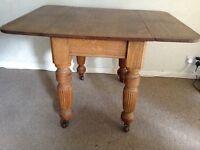 Vintage Solid Oak Table 2 Flaps Porcelain Casters Turned & Fluted Legs