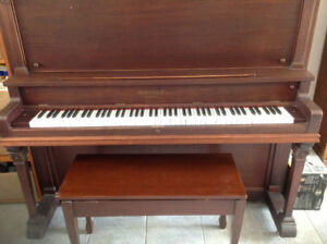 Heintzman upright piano made for the Mozart Piano Company.