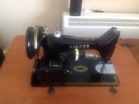 Antique Singer sewing machine in fold out table