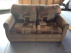 Like new.Love seat with fold out bed