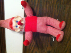 a vintage clown doll that plays music when you turn his nose!!