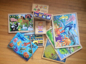 Lots of Melissa and Doug wooden toys and puzzles