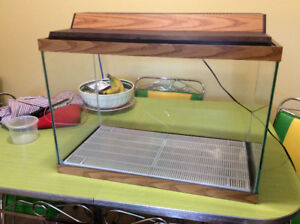 Fish/reptile tank with pump