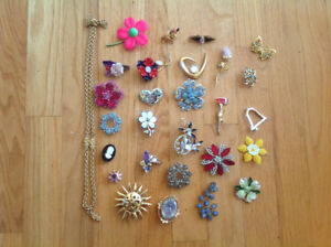 Large assortment of brooches and costume jewelry