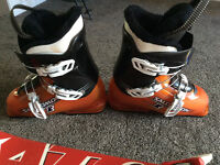 Size 4 boots brand new and atomic skis and bindings