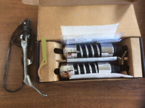 "Triumph 111 motorcycle 11.5"" shocks and 11"" custom stand $250."