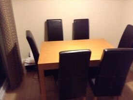 Solid wood table plus 6 leather chairs