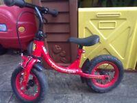"""Toddler Weeride balance bike, 10"""" wheels, red/black, front brake"""