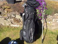 Golfing bag balls clubs trolley golf