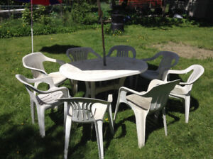 A patio table and 8 chairs
