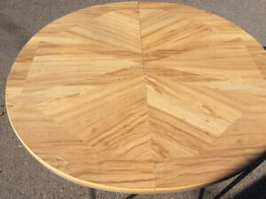 Round, simulated wood top extendable kitchen table $35.00