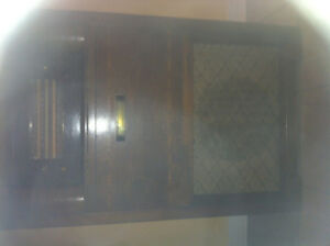 Antique Philco record player and radio visible