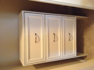 Two small white dressers