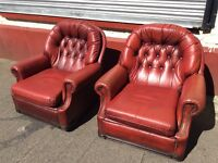 Leather buttonback armchairs