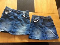 Two girls denim skirts