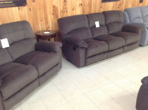 MATCHING FLOOR MODEL RECLINING SOFA AND LOVESEAT.