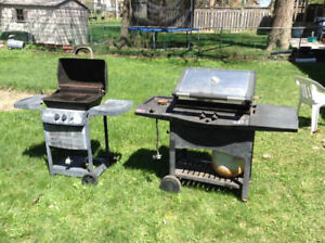 A mini BBQ & a full size BBQ with side burner with propane tanks