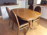 Extendable teak dining table and 6 chairs
