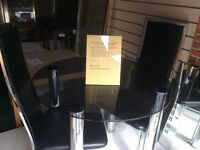 Black glass and chrome dining table and 2 chairs