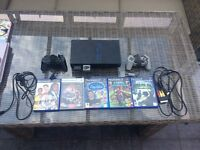 Ps2 in new condition, comes with two memory cards and with 5 games!