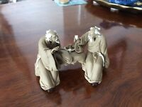 Small Asian clay hand-made sculpture of two seated monks