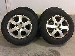 Four alloy rims with tires