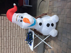 Blue Christmas lights and inflatable Olof