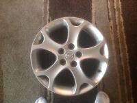 OEM rim for '08 Mazda 5 $100 O.B.O.
