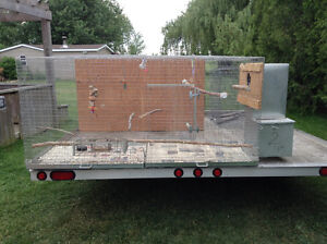 Breeding cage with boot shape nest box