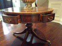 Really nice foyer drum table with pull out drawers