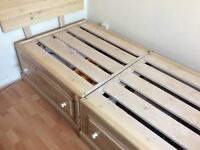 single wooden bed with draws