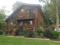 Log Home (Chalet Style) in Crapaud.  (Outdoor Pics)