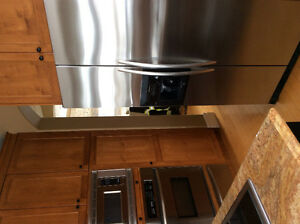 STAINLESS STEEL REFRIGERATOR. GREAT CONDITION