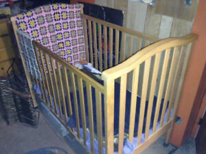 PINE WOODEN BABY CRIB WITH PLASTIC COVERED MATTRESS