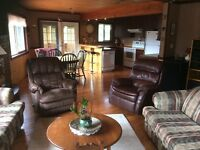 Large family Home with In law suite and log cabin.