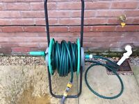 Hose pipe and reel.
