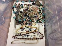 Broken jewellery, gemstones.