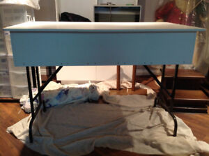 Very sturdy white table with folding legs