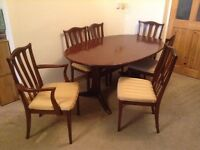 Six seater extending dark wood dining table and chairs