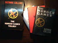 The Hunger Games, Catching Fire, Mockingjay - by Suzanne Collins
