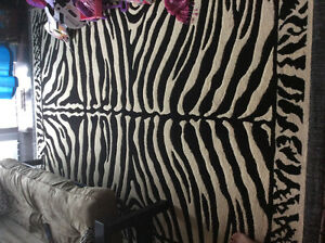 9x12 foot zebra rug 100$  like new. Delivery included!