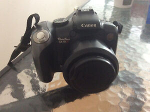 Canon Powershot SX10IS 10MP Digital Camera with 20x Wide Angle O
