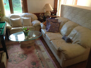 A 3 year new Canadian made cream leather sofa set can deliver