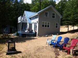 Waterfront Chalet à vendre/ cottage for sale lac Sinclair.Qc