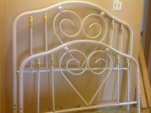 White iron headboard and footboard, double bed.
