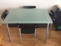 Glass ikea dining table and stacking chairs