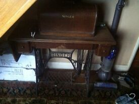 Old singer sewing machine in cabinet ..