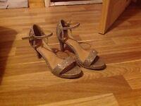 Sparkly gold high heels.