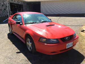 Red Ford Mustang Coupe (2 door)