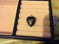Old locket in memory of on frunt